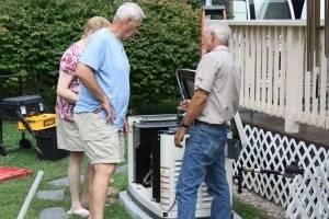 Hale's technician show new customer their generator
