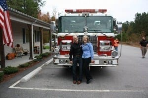 David and Tanya Hale in Front of Dinwiddie Firetruck