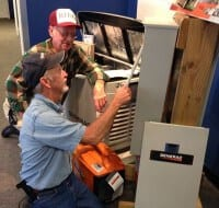 Sales Specialist showing Transfer Switch to a Customer