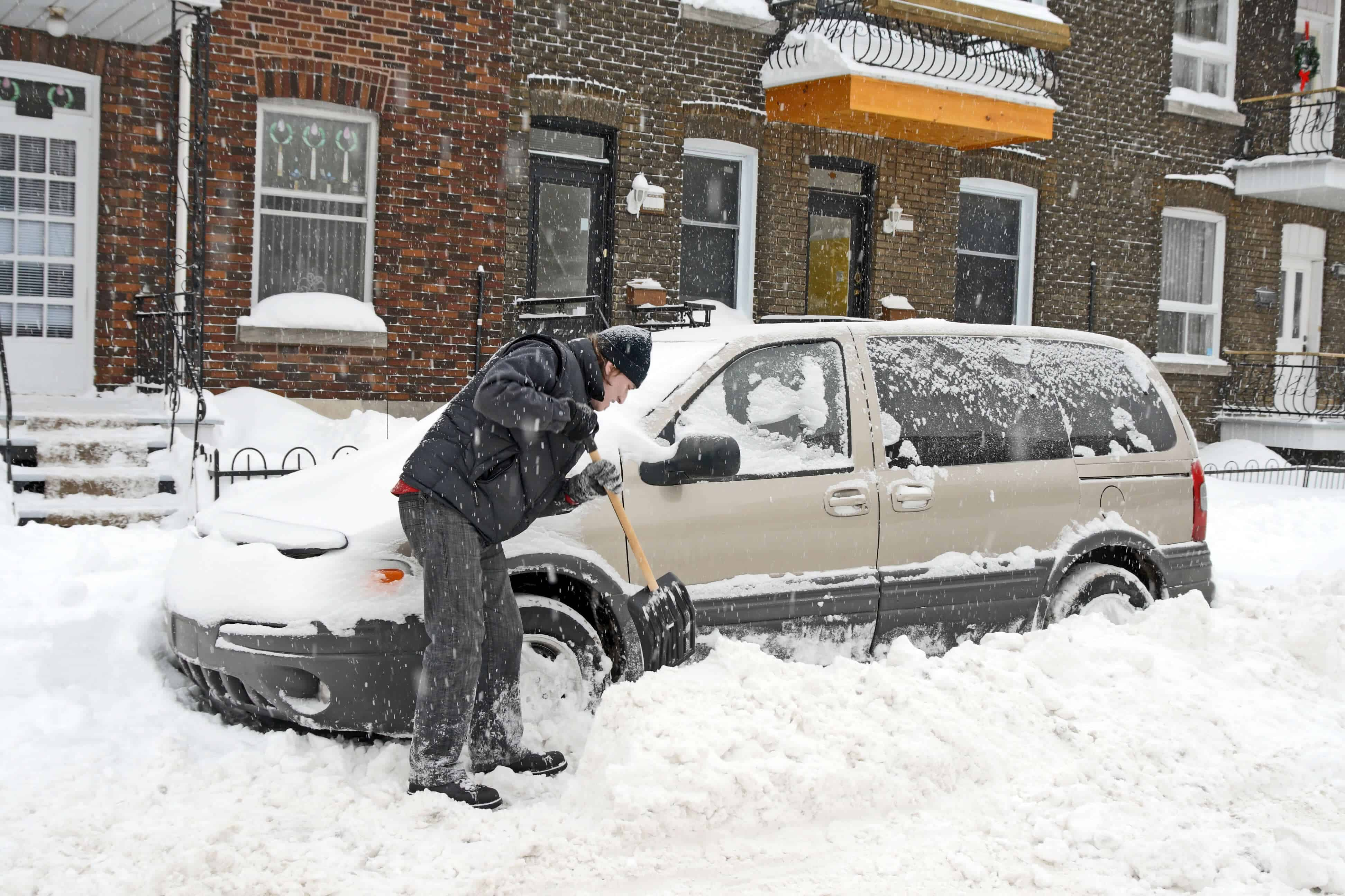 Shoveling Snow Around Car