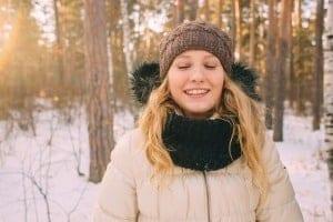 Happy Woman in Snowy Forrest