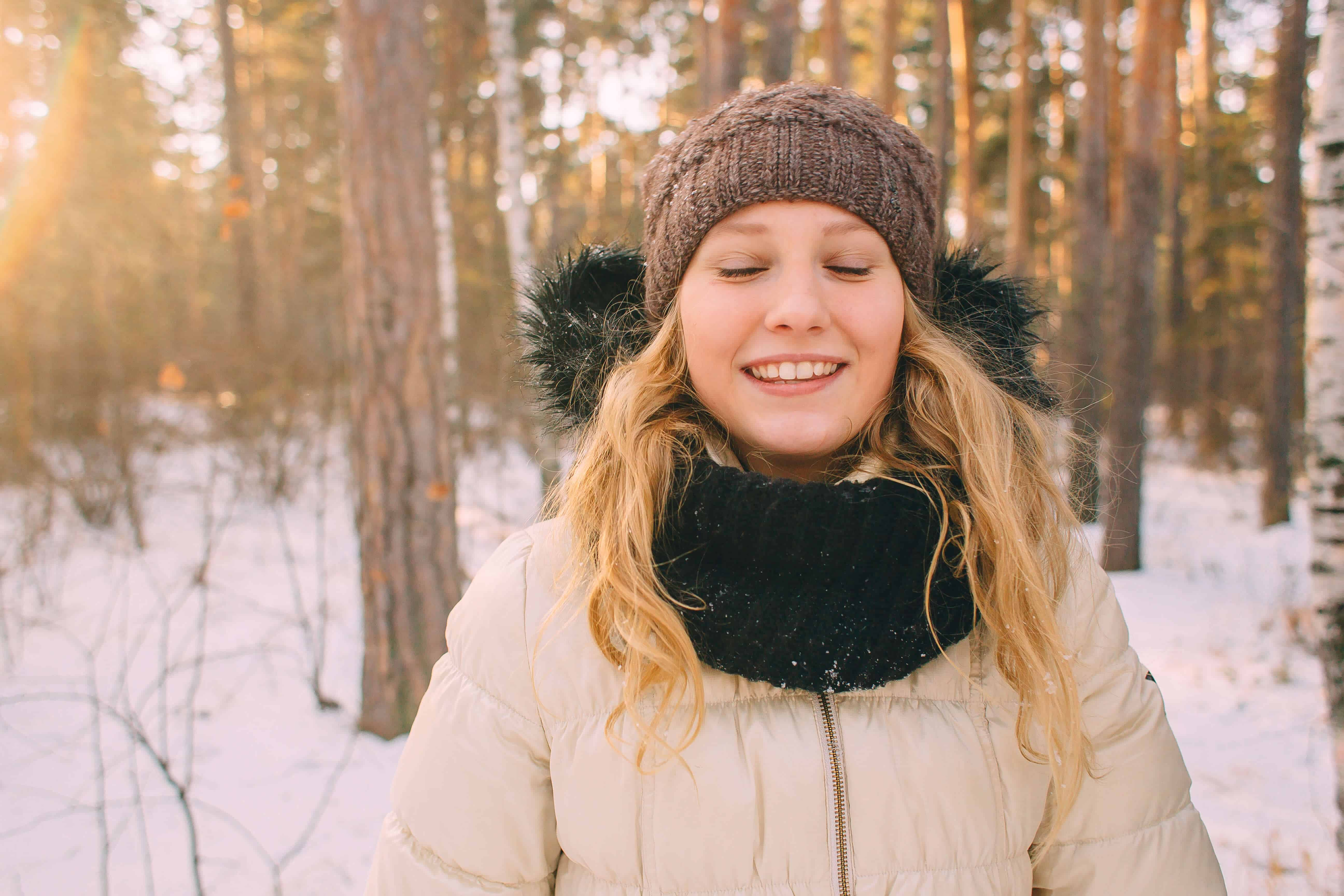 Happy Woman in Snowy Forrest